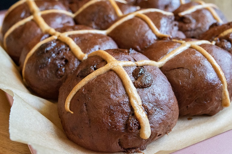 Close up image tray of double chocolate hot cross buns
