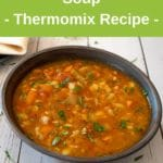 thermomix vegetable soup in bowl on white wood table, green banner above with recipe title, thermobexta logo below image