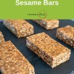 sesame bars lined up on black slate tile, green pinterest banner