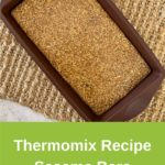 sesame bars in slice form on woven placemat and white background, green pinterest banner