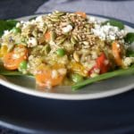 Thermomix risotto on light coloured plate on top of darker larger plate