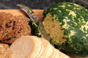 thermomix entertaining cheese ball on board with crackers and knife