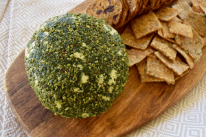 jalapeno cheese ball on board with crackers