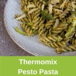 Plate of pesto and broccoli pasta, banner for pinterest