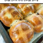 close up of corner of a tray of hot cross buns, Pinterest pin